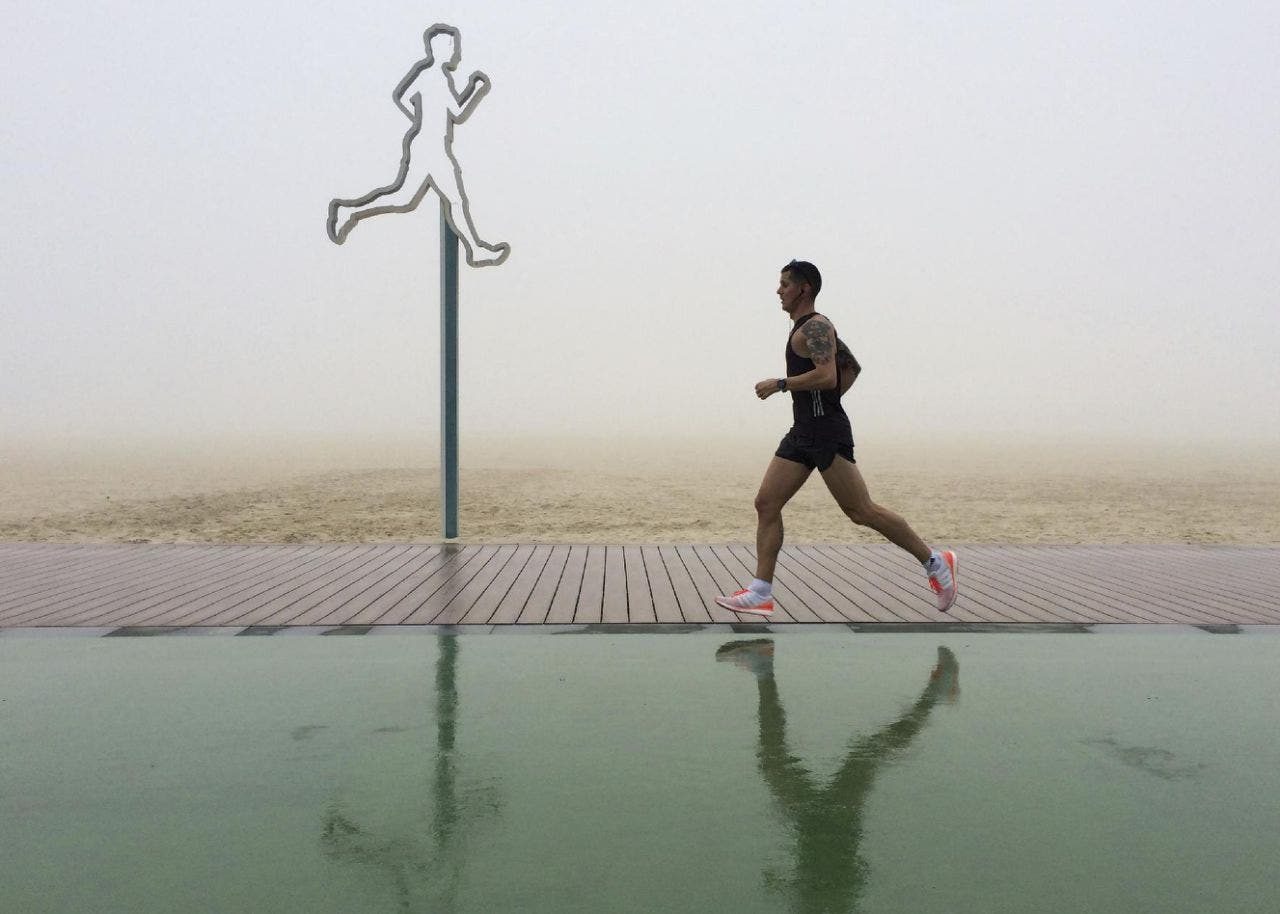 A man jogs in the fog at the Umm Suqeim beach in Dubai, United Arab Emirates, Wednesday, Dec. 28, 2016. A heavy seasonal fog engulfed the skyscraper-lined skyline of Dubai for several hours, causing some flights to be delayed at the world's busiest international airport. (AP Photo/Kamran Jebreili)