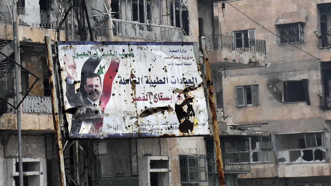 A general view shows a poster of Syria's President Bashar al-Assad in Aleppo's Bustan al-Qasr neighbourhood after Syrian pro-government forces captured the area in the eastern part of the war torn city on December 13, 2016. afp