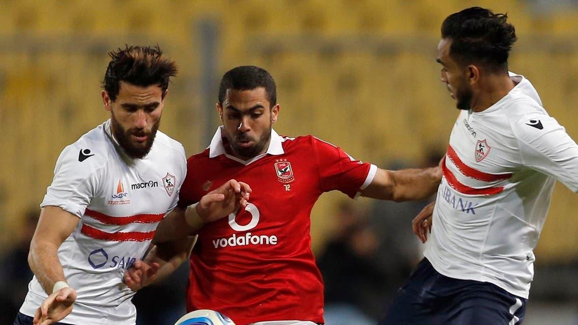 "Al-Ahly's Ahmed Fathie (C) fights for the ball with El Zamalek's Mahmoud Kahraba (R) and Basem Mursi during their Egyptian Premier League derby soccer match at Borg El Arab ""Army Stadium"" near Alexandria, Egypt, February 9, 2016. (Reuters)"