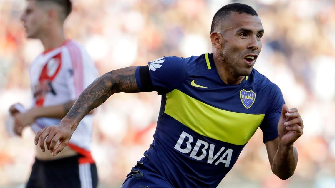 In this Sunday, Dec. 11, 2016 file photo, Boca Juniors' forward Carlos Tevez celebrates scoring against River Plate during a local tournament soccer match in Buenos Aires, Argentina. Argentine striker Carlos Tevez has signed to play for Shanghai Shenhua, becoming the latest in a procession of star players to join the Chinese Super League. Shanghai Shenhua said Thursday Dec. 29, 2016, that it paid an $11 million transfer fee to Argentine club Boca Juniors. (AP)