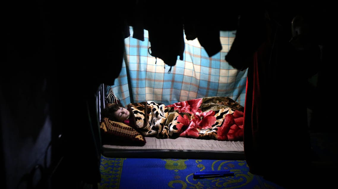 A displaced Iraqi child from the Shabak community, who fled fighting between Islamic State (IS) group jihadists and Peshmerga fighters around the northern Iraqi city of Mosul, sleeps inside a tent at the Baharka camp, 10 kms west of Arbil, the capital of the Kurdish autonomous region in northern Iraq, on January 16, 2015. AFP