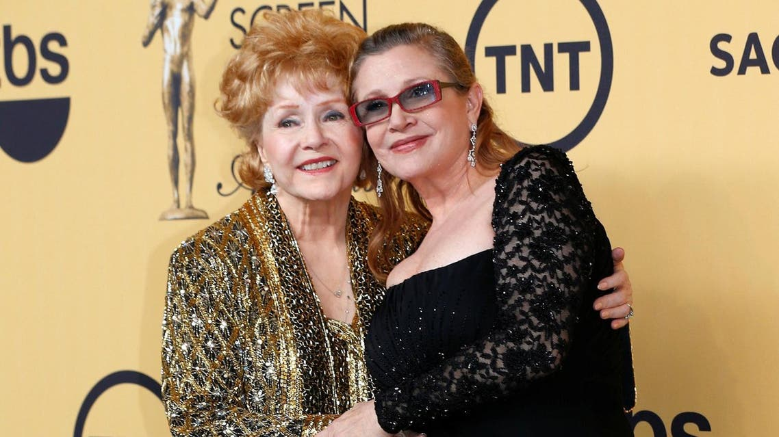 Actress Debbie Reynolds poses with her daughter actress Carrie Fisher backstage after accepting her Lifetime Achievement award at the 21st annual Screen Actors Guild Awards in Los Angeles. (File photo: Reuters)