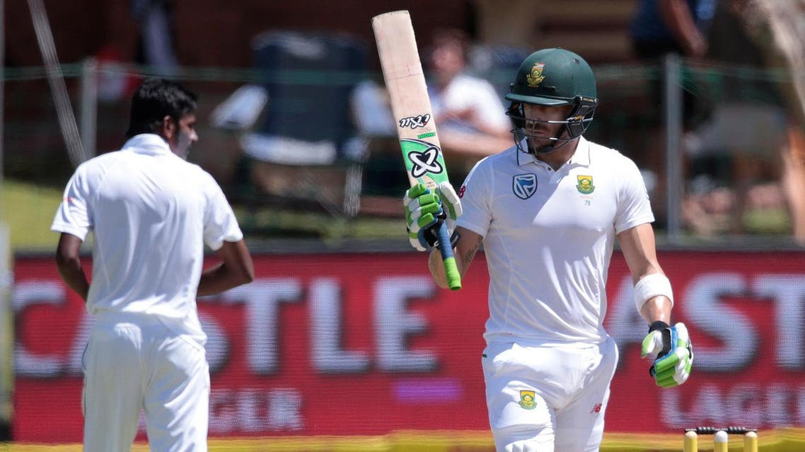 South African batsman and Captain Faf du Plessis (R) raises his bat as he celebrates scoring half century (50 runs) during the fourth day of the first Test between South Africa and Sri Lanka. (AFP)
