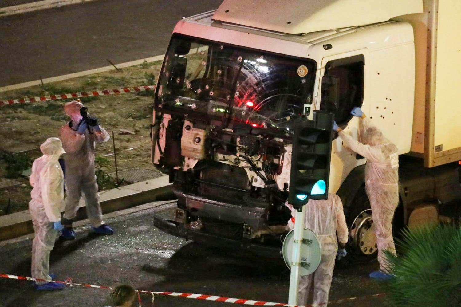 91: Authorities investigate a truck after it plowed through Bastille Day revelers in the French resort city of Nice, France, on July 14, 2016. (AP)