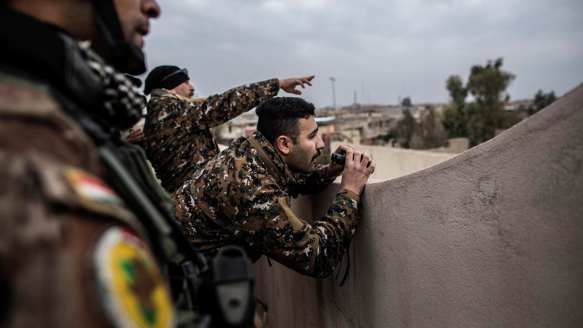 Iraqi members of the Special Forces scan the area held by Islamic state militants from a roof in Mishraq district in Mosul, Iraq, Tuesday, Dec. 20, 2016. Advancing into Mosul has become a painful slog for Iraqi forces. Islamic State group militants have fortified each neighborhood, unlike past battles where they concentrated their defenses in one part of the city. (AP)