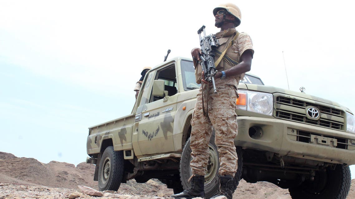 A Yemeni fighter loyal to President Abedrabbo Mansour Hadi stands guard next to a pick up truck near Kahbub, on a mountainous area overlooking the strategic Bab al-Mandab Strait at the entrance to the Red Sea, on September 15, 2016. (AFP)