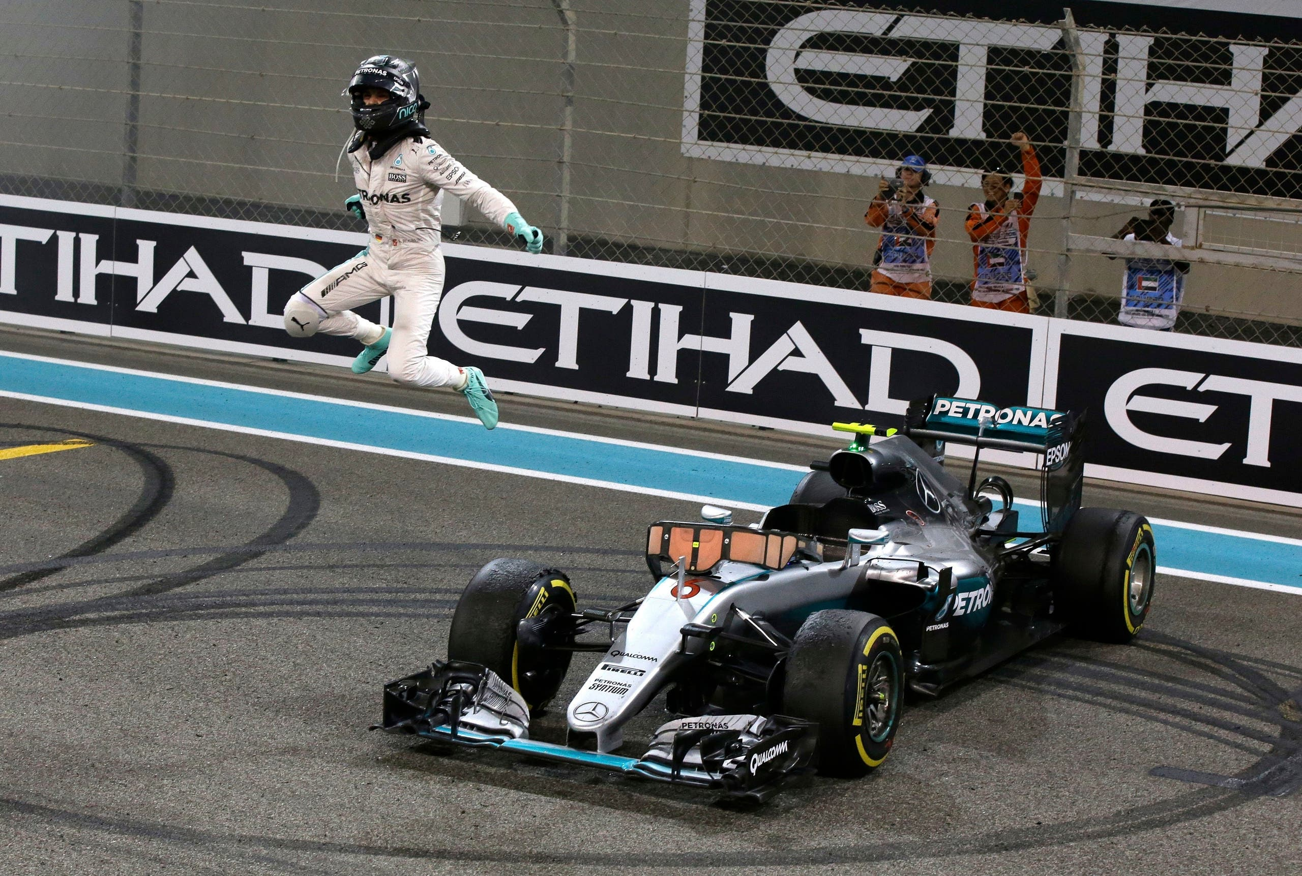 Mercedes driver Nico Rosberg of Germany celebrates after finishing second to win the 2016 world championship during the Emirates Formula One Grand Prix at the Yas Marina racetrack in Abu Dhabi, United Arab Emirates. (AP)