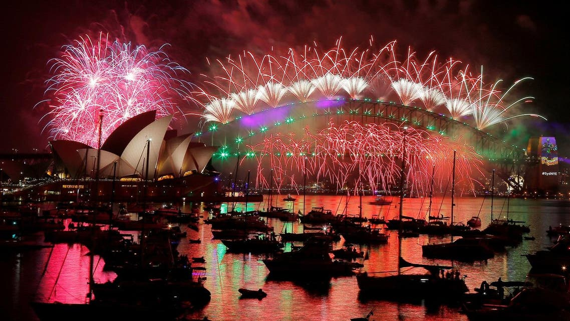 Fireworks explode over the Sydney Opera House and Harbour Bridge as Australia ushers in the New Year in Sydney. (Reuters)