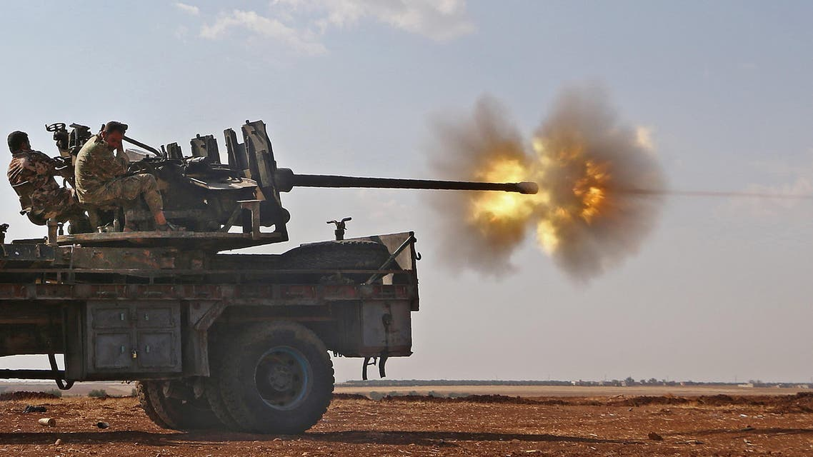 Fighters from the Free Syrian Army fire an anti-aircraft machine gun mounted on a vehicle deploy during fighting against the Islamic State (IS) group jihadists in the northern Syrian village of Yahmoul in the Marj Dabiq area north of the embattled city of Aleppo on October 10, 2016. (AFP)
