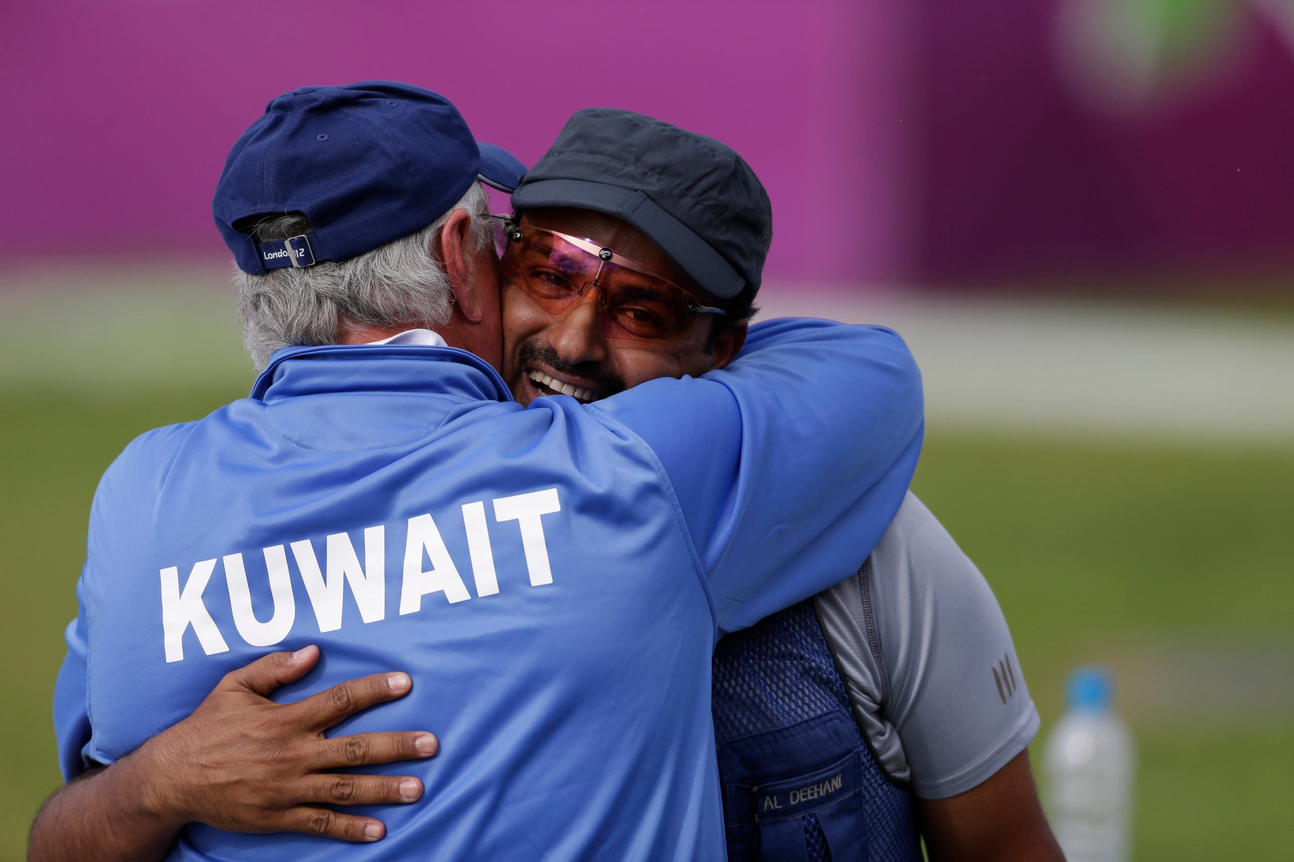 Kuwait's Fehaid Aldeehani is hugged by his coach after winning a shootout to secure the bronze medal, in the men's trap final, at the 2012 Summer Olympics, Monday, Aug. 6, 2012, in London. (AP)