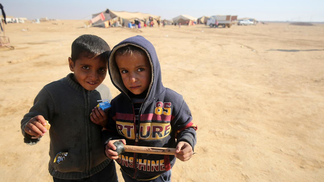 Displaced Iraqi children, from the outskirts of the city of Tal Afar, pose at a makeshift camp on December 12, 2016 in the village of Khalif Saleh, south of Tal Afar. (AFP)