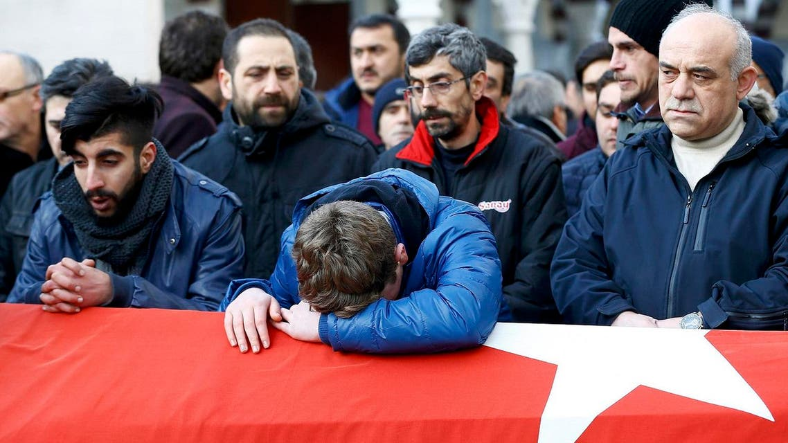 Relatives react at the funeral of Arik, a victim of an attack by a gunman at Reina nightclub. (Reuters)
