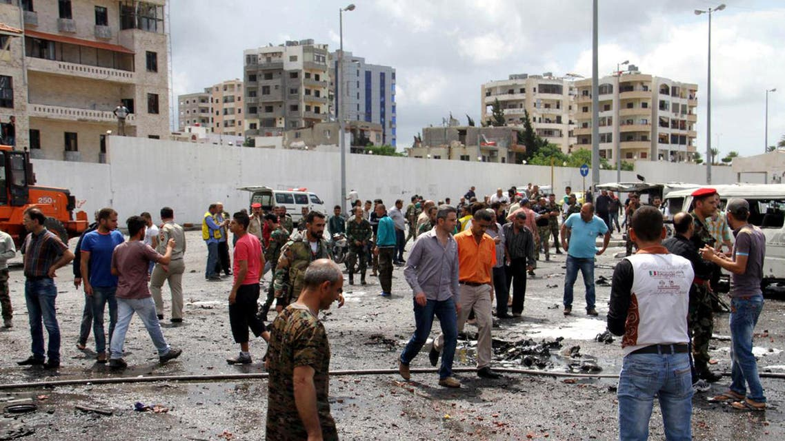 Syrian army soldiers and civilians inspect the damage after explosions hit the Syrian city of Tartous, in this handout picture provided by SANA on May 23, 2016. SANA/Handout via REUTERS ATTENTION EDITORS - THIS IMAGE WAS PROVIDED BY A THIRD PARTY. REUTERS IS UNABLE TO INDEPENDENTLY VERIFY THIS IMAGE. EDITORIAL USE ONLY.