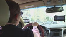 Women at wheel of 'pink taxis' challenge Jordan norms
