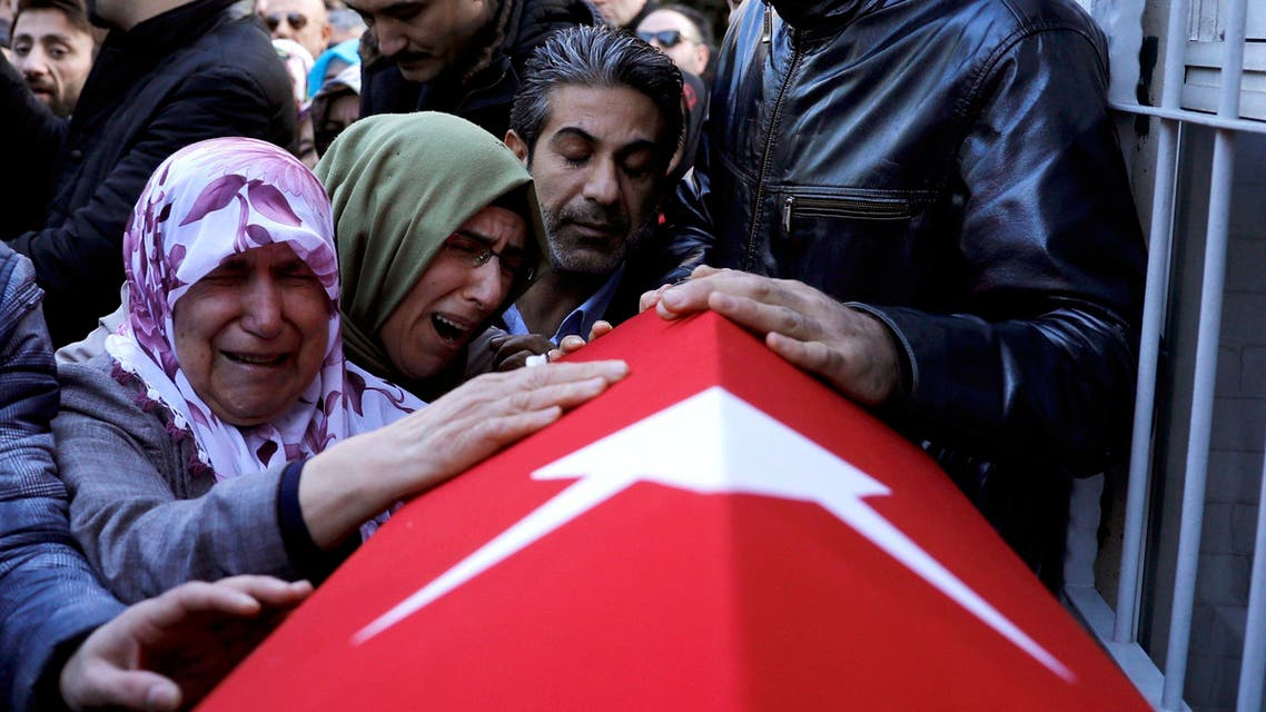 Relatives of Cakmak, a security guard and a victim of an attack by a gunman at Reina nightclub, react during his funeral in Istanbul. (Reuters)