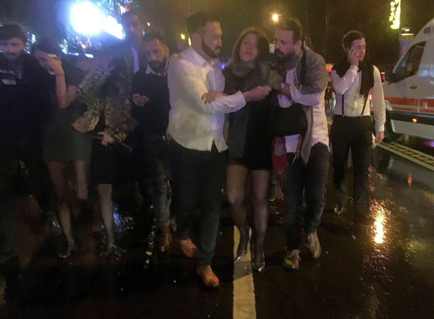 People leave the nightclub, the scene of an attack in Istanbul, early Sunday, Jan. 1, 2017 (DHA-Depo Photos via AP)