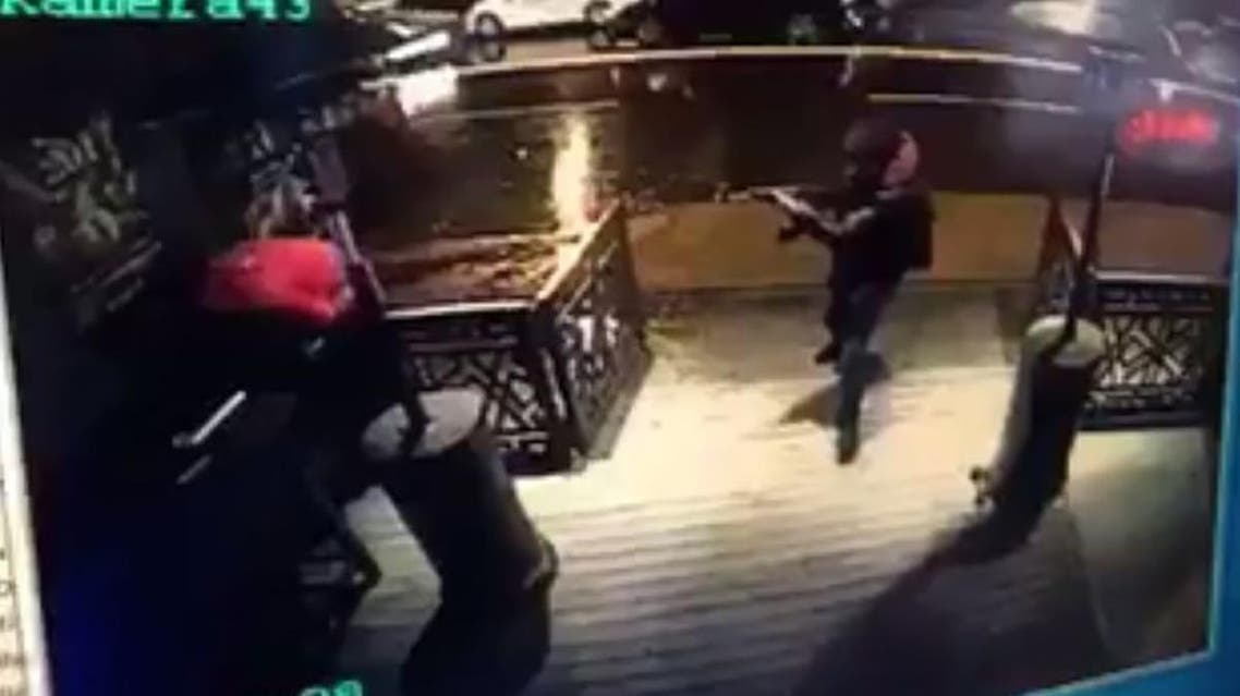 The gunman (Right) fires on a bystander during the Istanbul New Year's Eve massacre (AFP PHOTO / CCTV / STRINGER)
