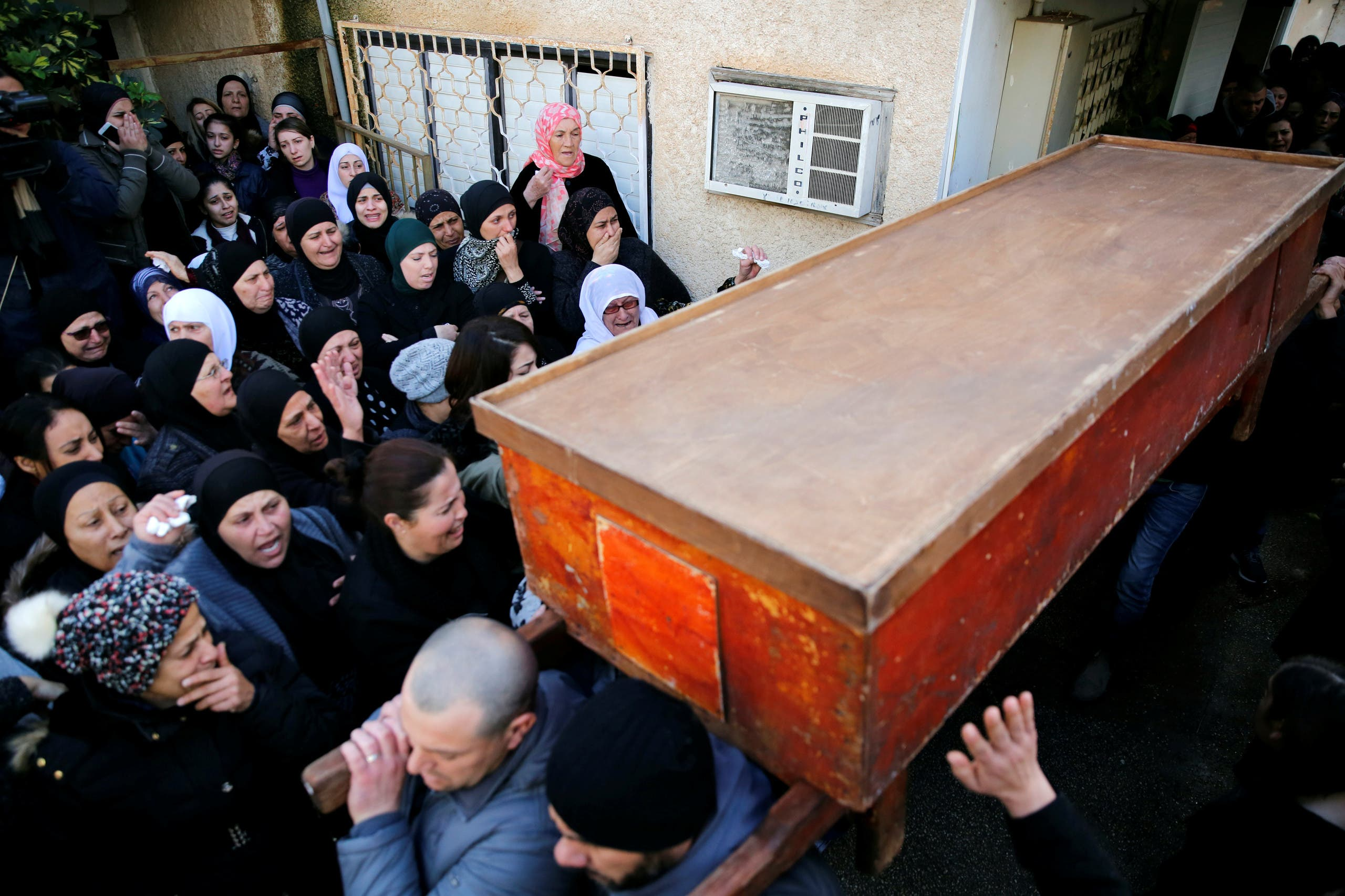 The coffin of Israeli woman, Leanne Nasser, who was killed in an Istanbul nightclub attack, is carried out of the family house to be buried at the Israeli town of Tira, Israel January 3, 2017. REUTERS/Ronen Zvulun