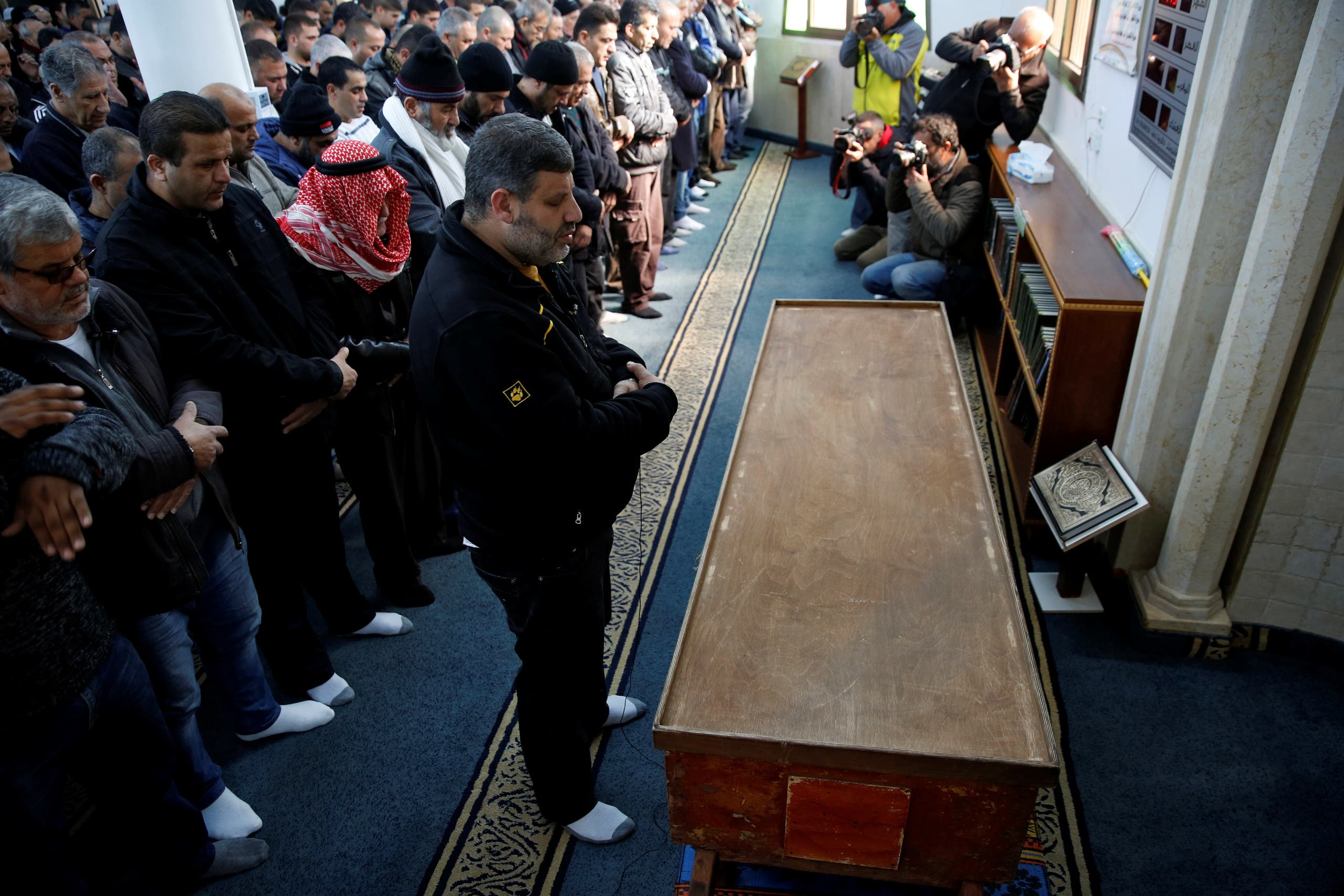 Relatives and friends pray next to the coffin of Israeli woman, Leanne Nasser, who was killed in an Istanbul nightclub attack, inside a mosque at the Israeli town of Tira, Israel January 3, 2017. REUTERS/Ronen Zvulun