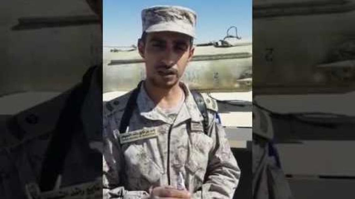 The video shows Saudi solider Yasser al-Shoaifan speaking in front of a destroyed scud missile. (via YouTube)