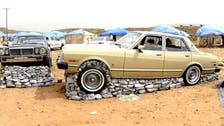 Mixing cars and rocks... a new Saudi art form