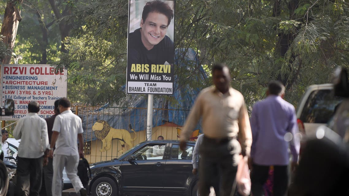 Pedestrians walk past a hoarding put up in memory of deceased Indian businessman and film producer Abis Rizvi ahead of his funeral in Mumbai on January 4, 2017. (AFP)