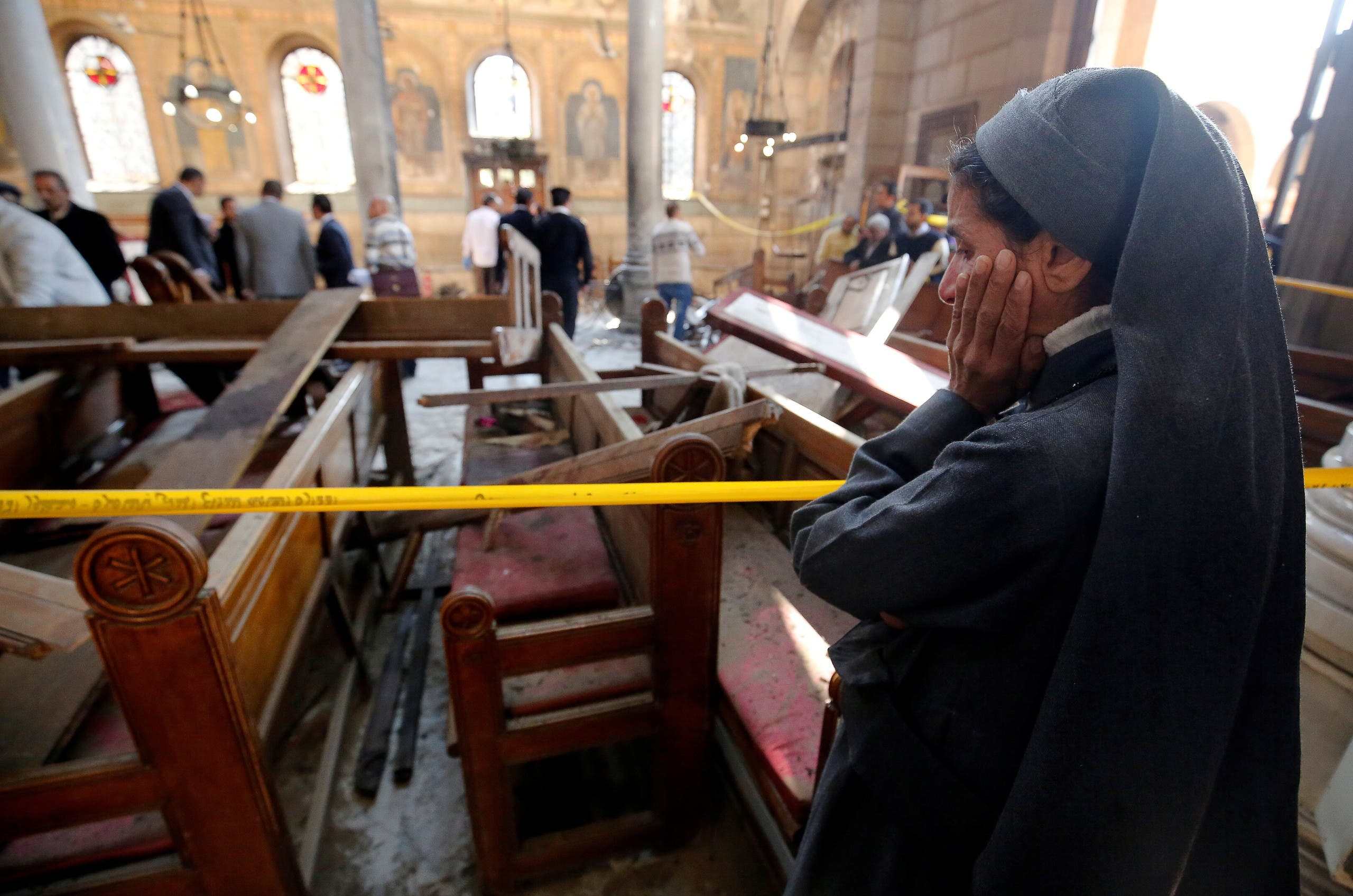 A nun cries as she stands at the scene inside Cairo's Coptic cathedral, following a bombing, in Egypt December 11, 2016. REUTERS
