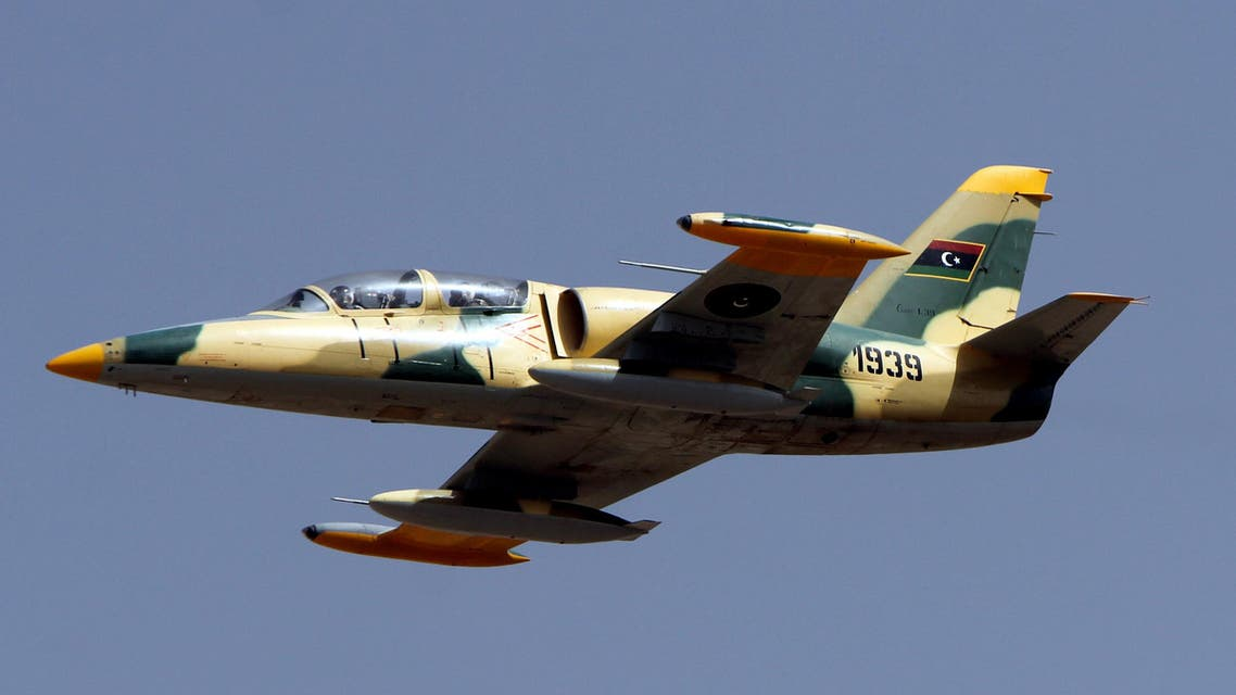 A Libyan fighter jet flies over the eastern city of Benghazi during a military parade to celebrate the second anniversary of NATO's first military operation in Libya on March 19, 2013. (File photo: AFP)