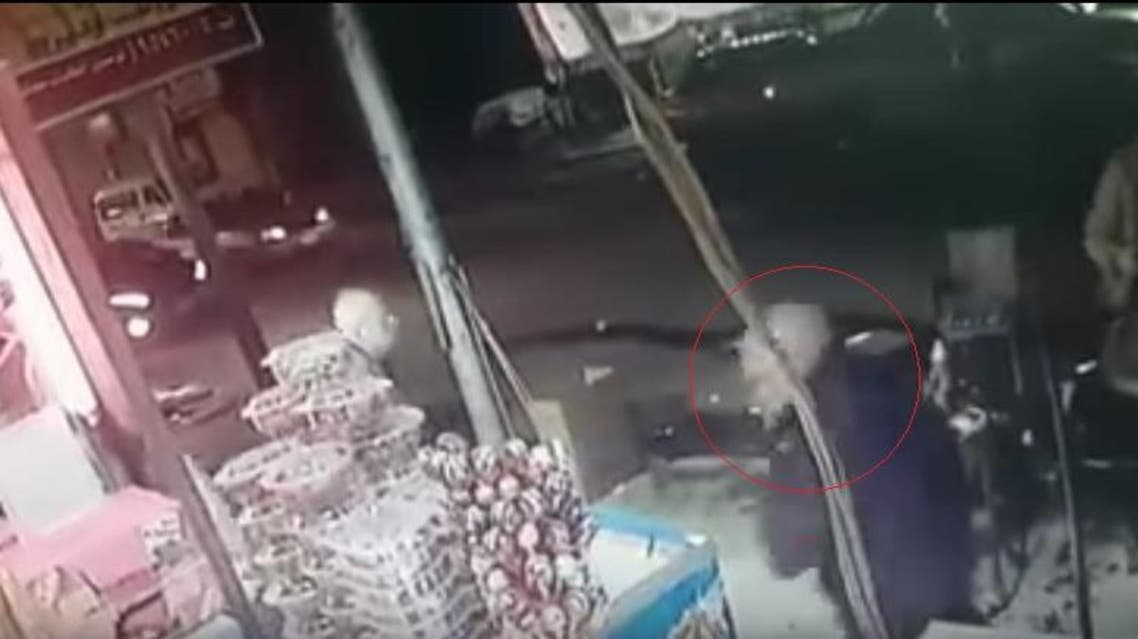 The suspect, who has been arrested, came up behind the victim and slashed his throat while he was sitting in front of his shop. (Screengrab)