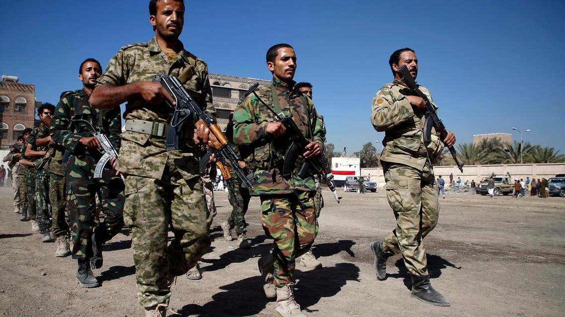 Houthi rebels, dressed in army fatigues, march in a parade during a gathering in the capital Sanaa to mobilize more fighters to battlefronts to fight pro-government forces in several Yemeni cities, on January 1, 2017. (AFP)