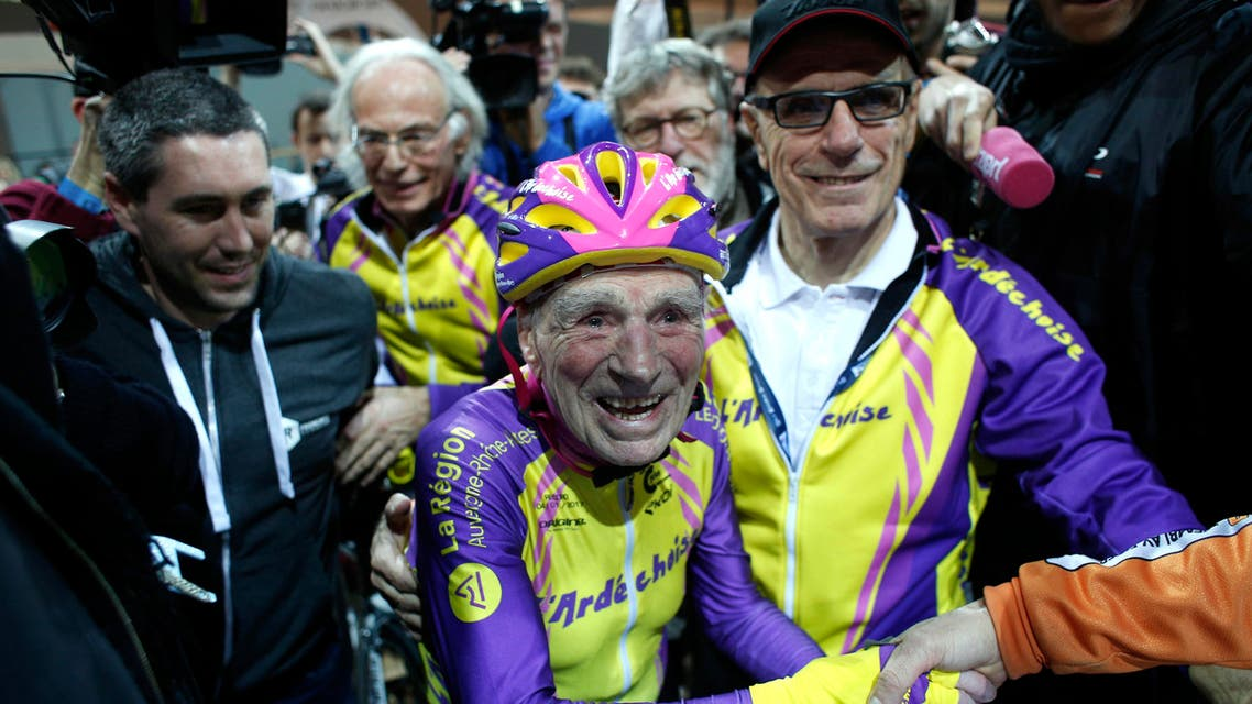 French cyclist Robert Marchand, 105, is cheered after setting a record for distance cycled in one hour, at the velodrome of Saint-Quentin en Yvelines, outside Paris, Wednesday, Jan. 4, 2017. The Frenchman set a world record in the 105-plus age category -- created especially for the tireless veteran -- by riding 22.547 kilometers in one hour. (AP