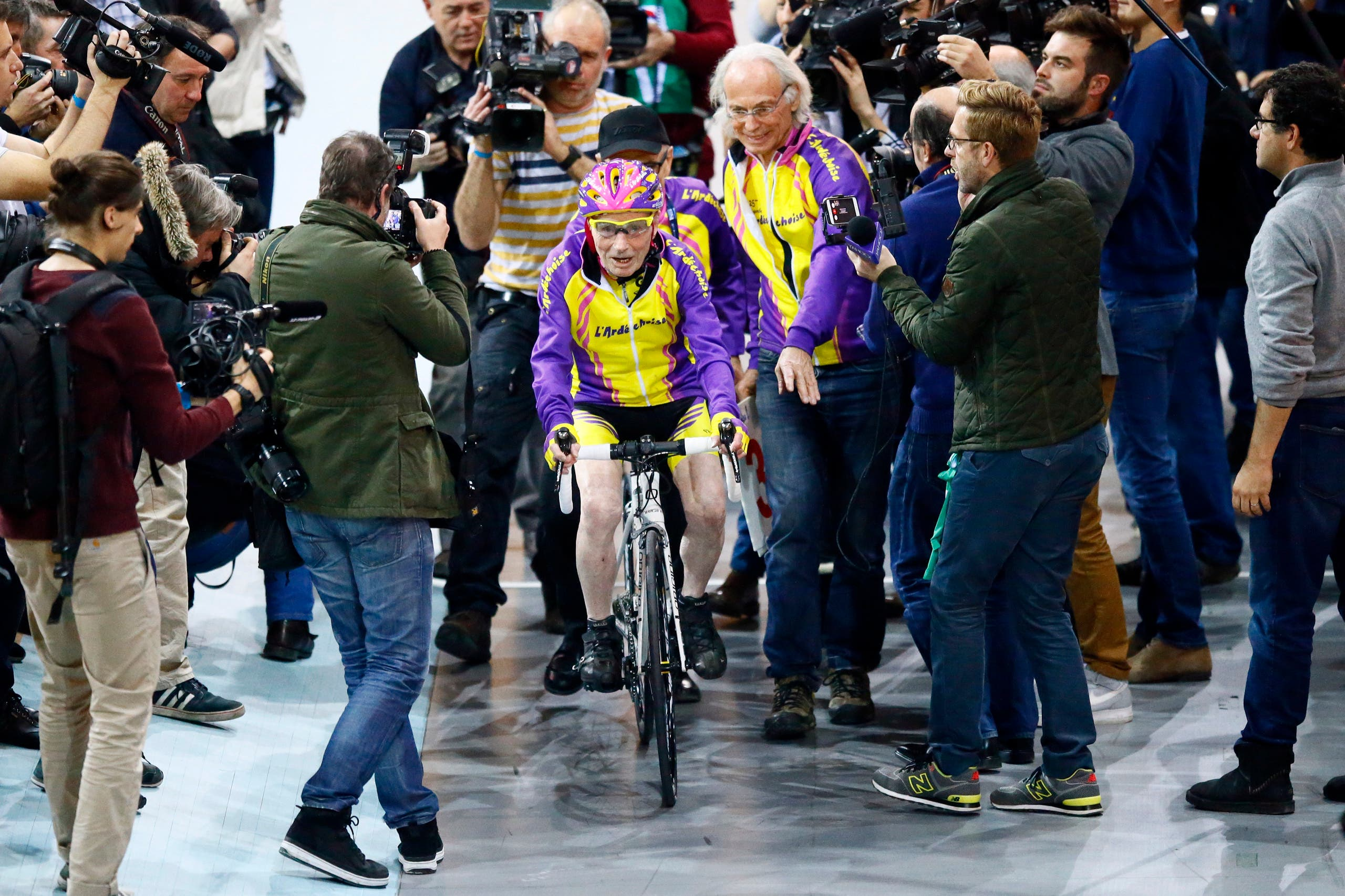 French cyclist Robert Marchand, aged 105, prepares to warm up prior to cycle in a bid to beat his record for distance cycled in one hour, at the velodrome of Saint-Quentin en Yvelines, outside Paris, Wednesday, Jan. 4, 2017. (AP)