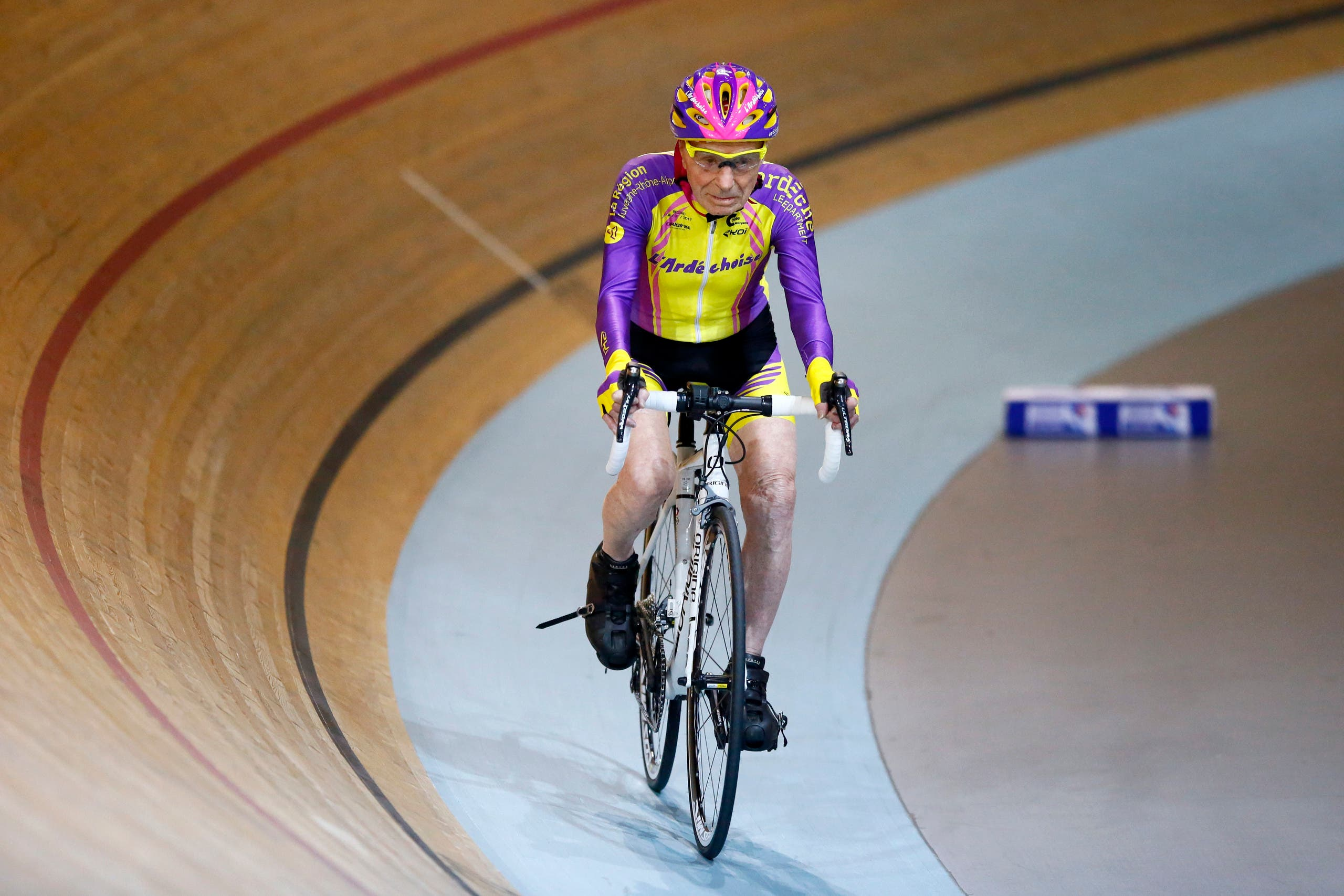 French cyclist Robert Marchand, aged 105, cycles to set a record for distance cycled in one hour, at the velodrome of Saint-Quentin en Yvelines, outside Paris, Wednesday, Jan. 4, 2017. (AP)