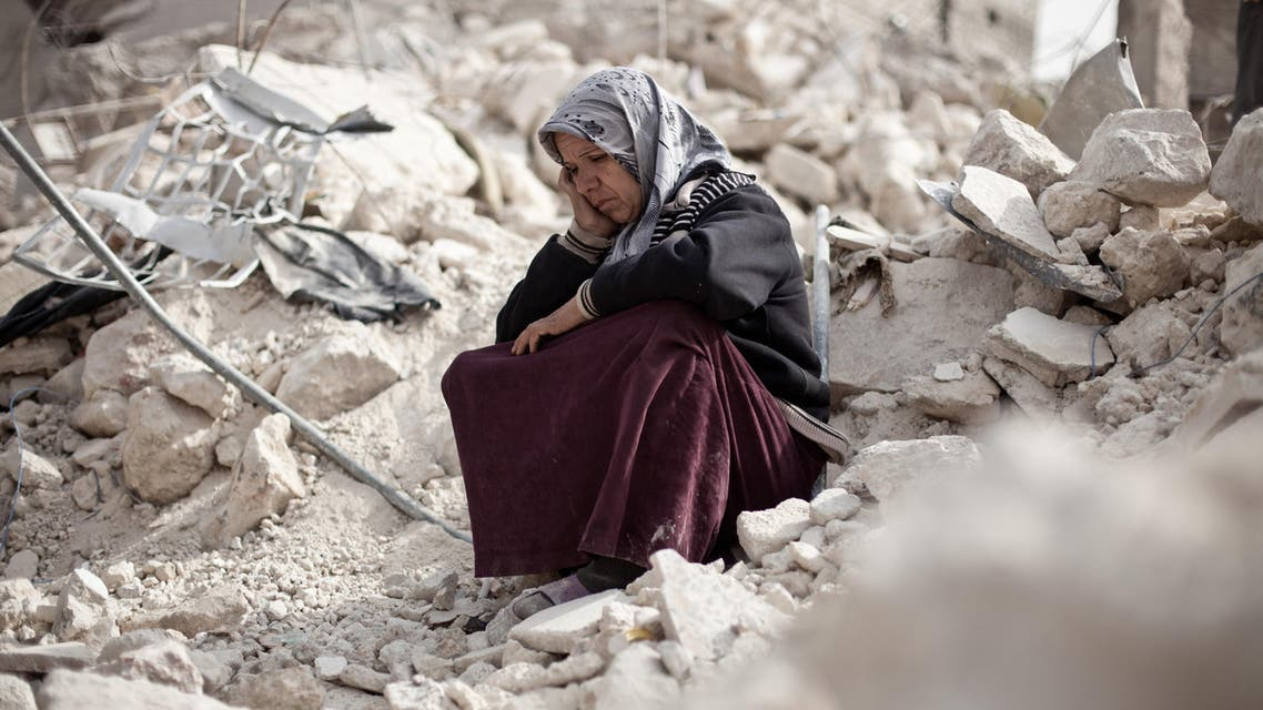 Syrian Zakia Abdullah sits on the rubble of her house in the Tariq al-Bab district of the northern city of Aleppo on February 23, 2013. Three surface-to-surface missiles fired by Syrian regime forces in Aleppo's Tariq al-Bab district have left 58 people dead, among them 36 children, the Syrian Observatory for Human Rights said on February 24. AFP