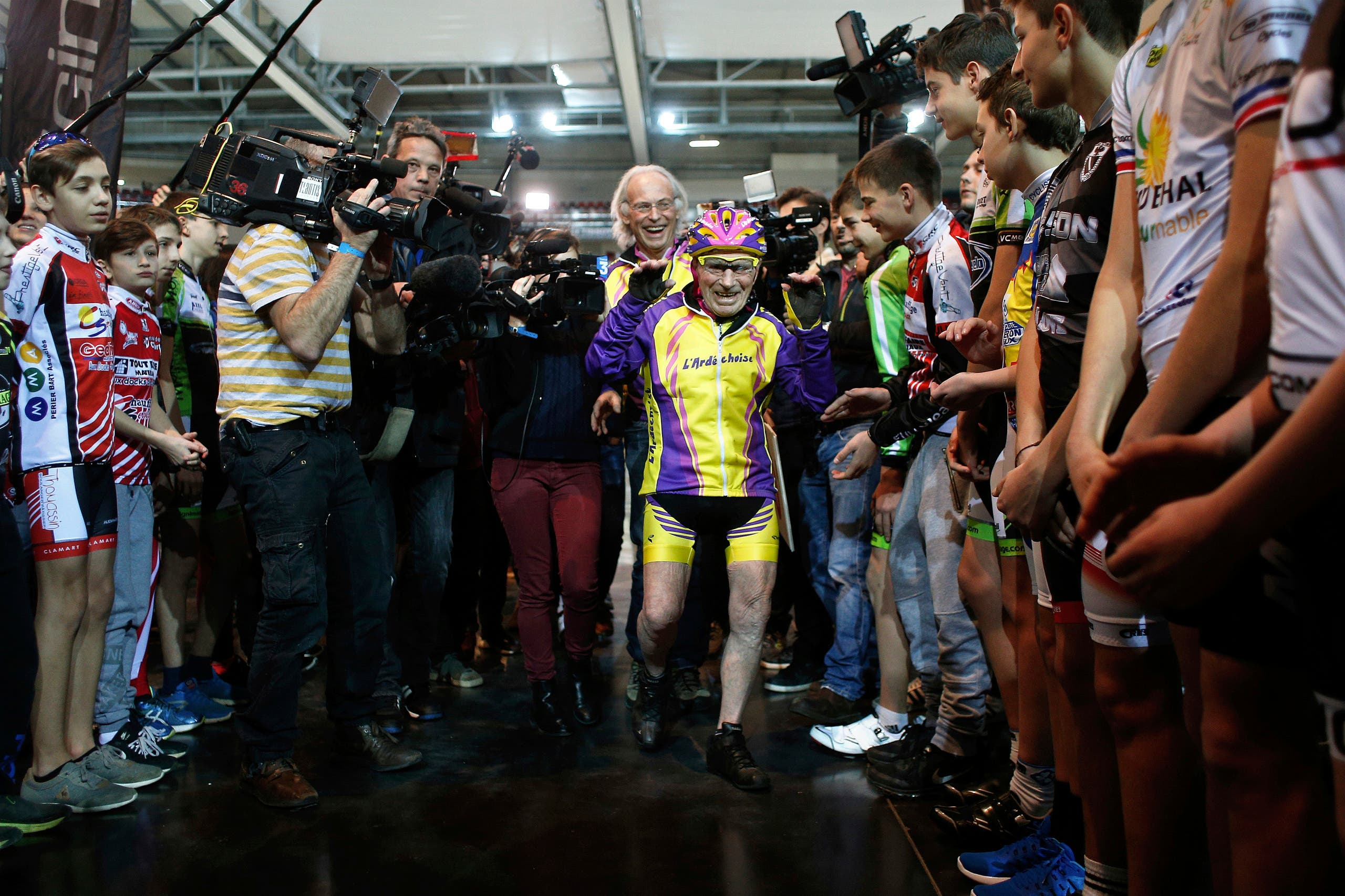 French cyclist Robert Marchand, aged 105, arrives prior to cycle in a bid to beat his record for distance cycled in one hour, at the velodrome of Saint-Quentin en Yvelines, outside Paris, Wednesday, Jan. 4, 2017. (AP)