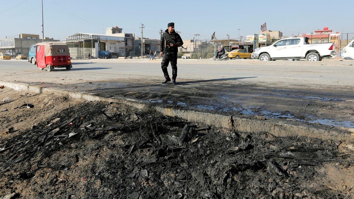 A member of Iraqi security forces stands at the site of car bomb attack in the predominately Shi'ite Muslim neighbourhood of al-Obaidi, Iraq, January 5, 2017. reuters