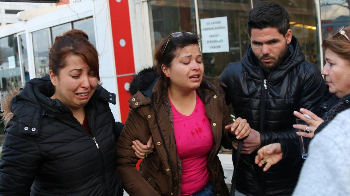 People react after an explosion outside a courthouse in Izmir. (Reuters)