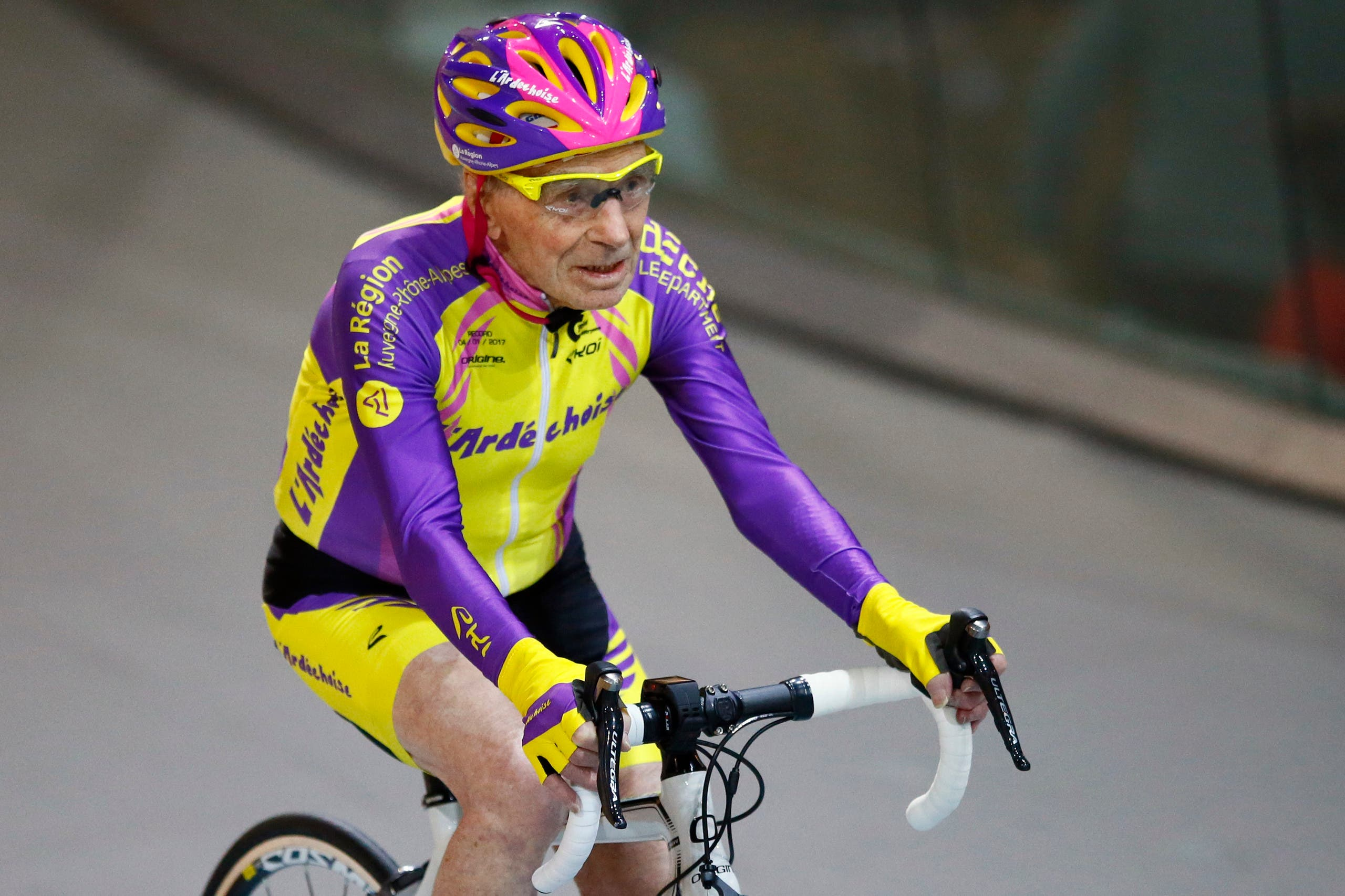 French cyclist Robert Marchand, aged 105, finishes after setting a record for distance cycled in one hour, at the velodrome of Saint-Quentin en Yvelines, outside Paris, Wednesday, Jan. 4, 2017. (AP)