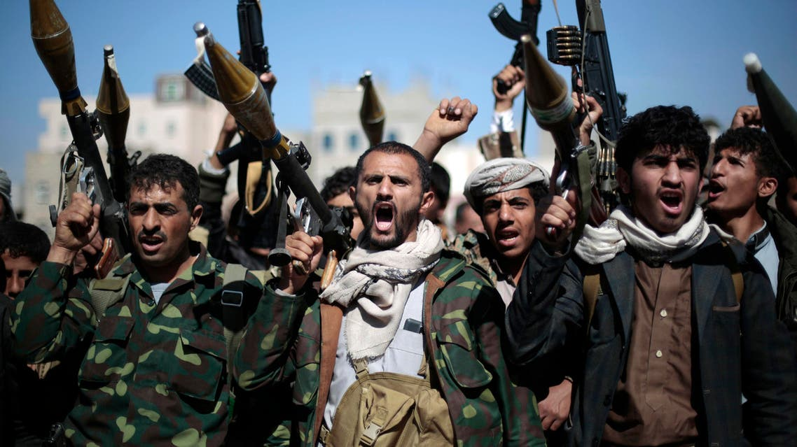 In this Thursday, Nov. 24, 2016 file photo, tribesmen loyal to Houthi rebels hold their weapons as they chant slogans during a gathering to mobilize more fighters into battlefronts in several Yemeni cities, in Sanaa, Yemen. AFP