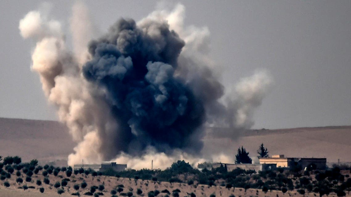 This picture taken from the Turkish Syrian border city of Karkamis in the southern region of Gaziantep, on August 24, 2016 shows smoke billows following air strikes by a Turkish Army jet fighter on the Syrian Turkish border village of Jarabulus during fighting against ISIS targets. (AFP)