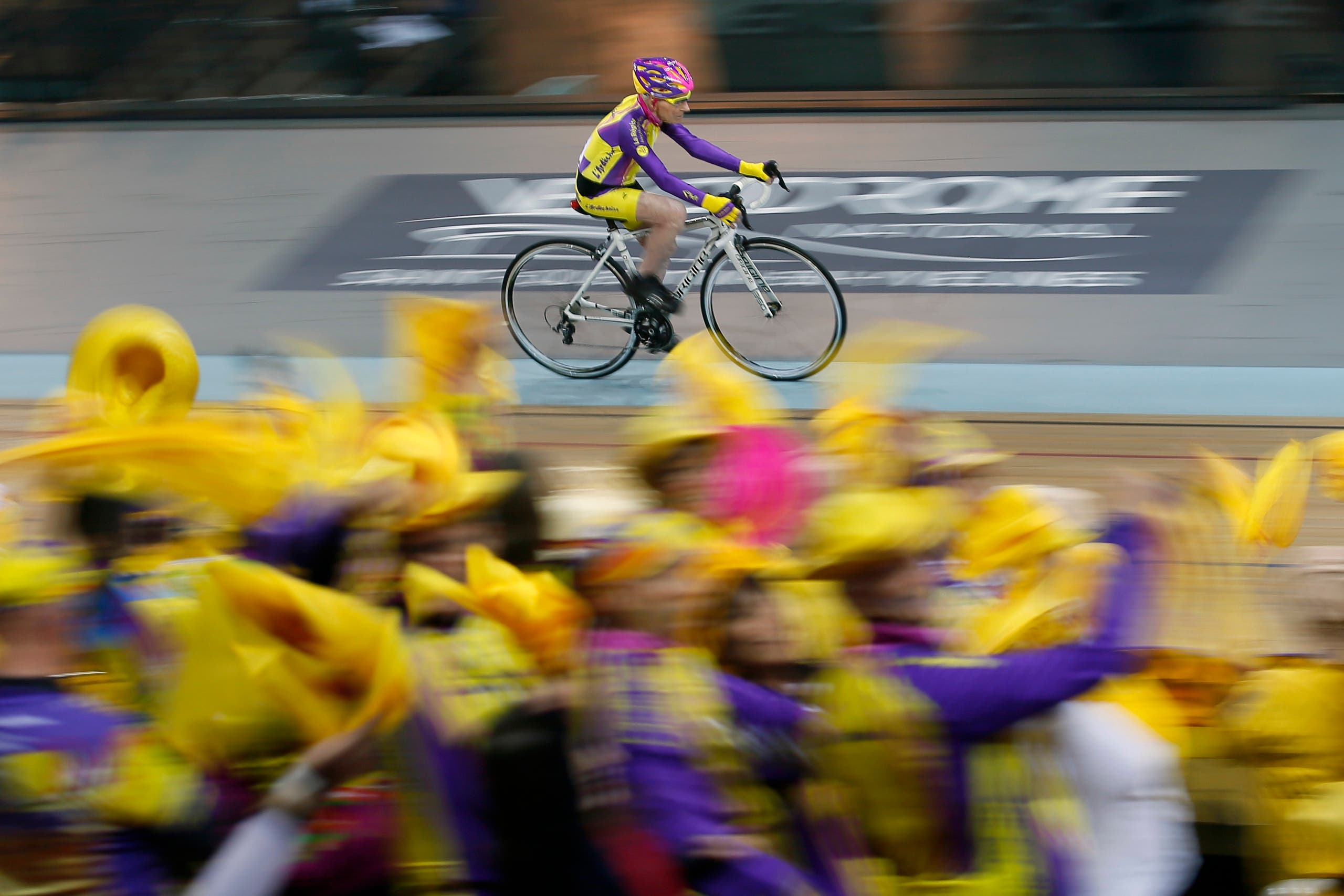 French cyclist Robert Marchand, aged 105, cycles in a bid to beat his record for distance cycled in one hour, at the velodrome of Saint-Quentin en Yvelines, outside Paris, Wednesday, Jan. 4, 2017. (AP)