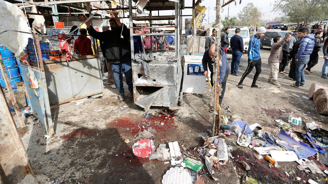 People look at wreckage at the site of car bomb attack in a busy square at Baghdad's sprawling Sadr City district, in Iraq January 2, 2017