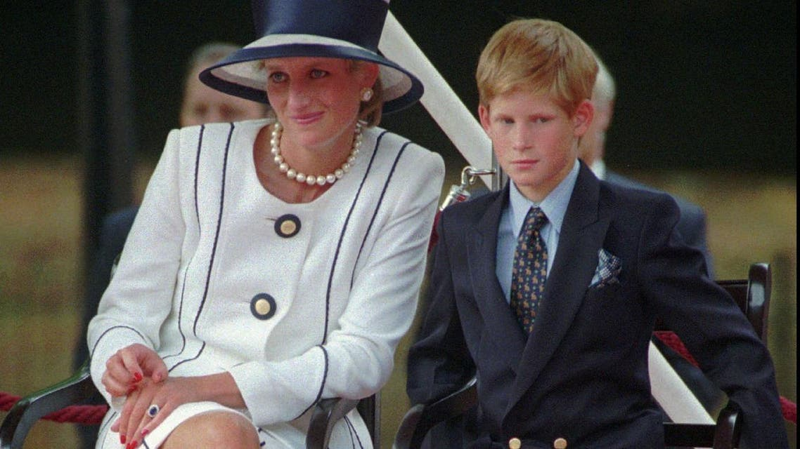 In this Aug. 19, 1995 file photo, Britain's Princess Diana, left, sits next to her younger son Prince Harry during V-J Day celebrations in London. (AP)
