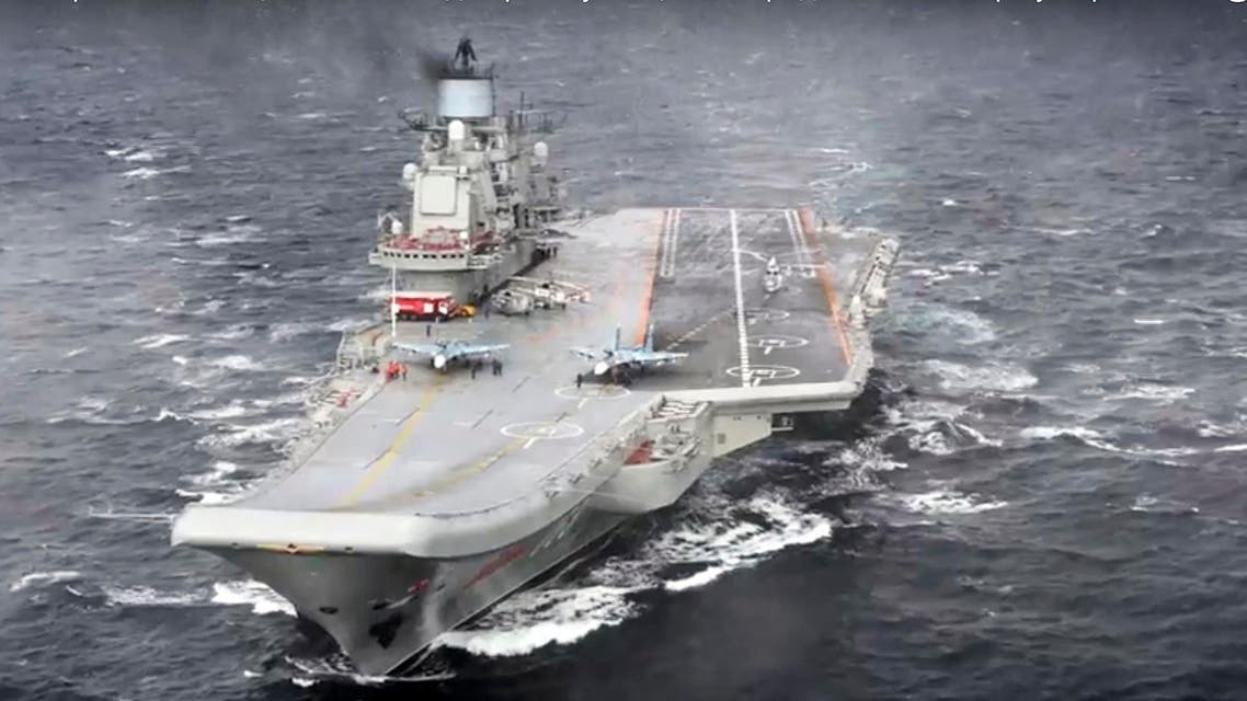 In this photo made from the footage taken from Russian Defense Ministry official web site on Wednesday, Jan. 4, 2017, the Admiral Kuznetsov aircraft carrier during its mission in the eastern Mediterranean Sea. AP