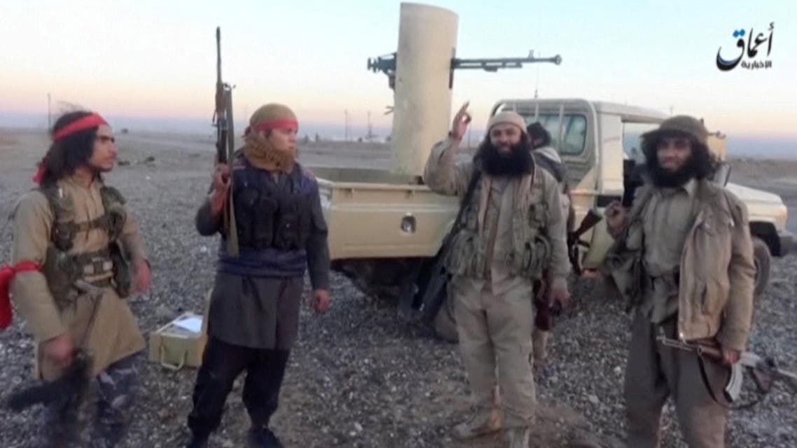 Militants, said to be from the Islamic State, speak in front of a camera during clashes against Shi'ite militia fighters at a checkpoint on the road linking Baghdad to Mosul, in Zawiya, southwest of al-Shirqat, Iraq, in this still image taken from an undated video from a social media website January 3, 2017