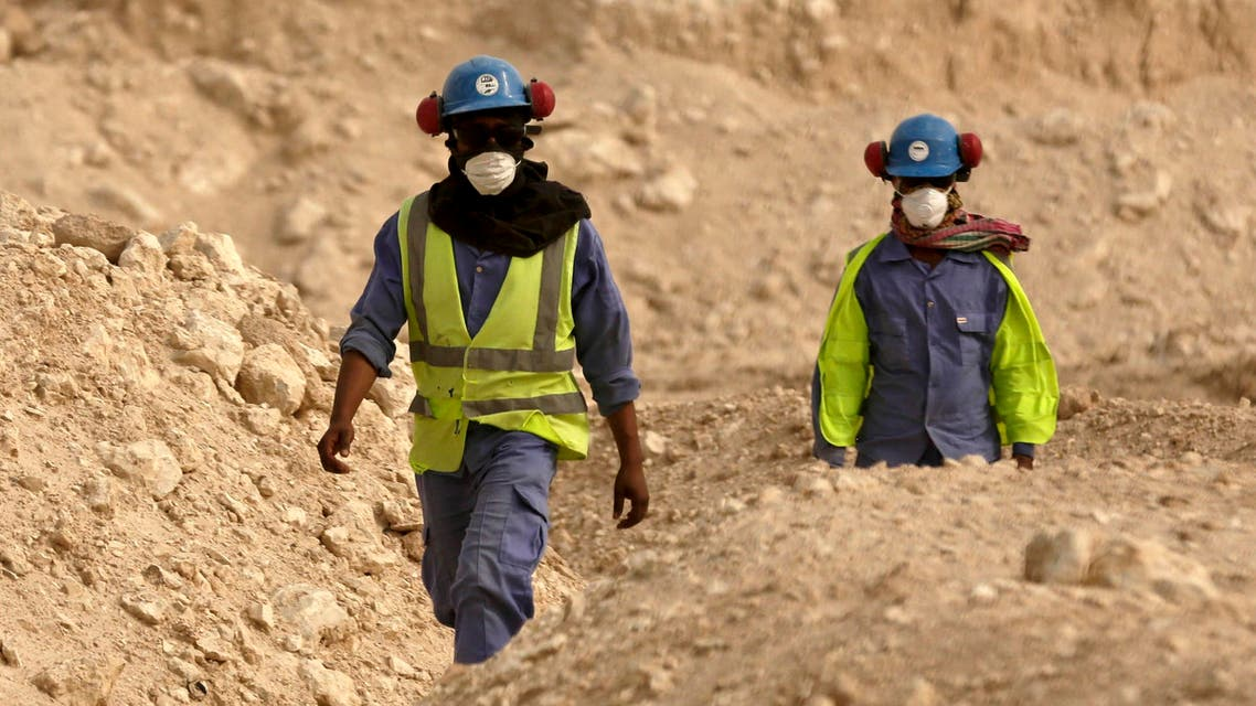 In this file photo taken Monday, May 4, 2015, during a government organized media tour, workers walk back to the Al-Wakra Stadium worksite being built for the 2022 World Cup, in Doha, Qatar. ap