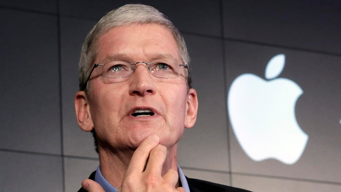 """FILE - In this April 30, 2015, file photo, Apple CEO Tim Cook responds to a question during a news conference at IBM Watson headquarters, in New York. CEOs of major companies are taking stands about the results of the November 2016 U.S. election, a departure from the traditional model of not mixing politics with business that the major brands have long espoused. Cook is telling his employees to """"keep moving forward."""" (AP Photo/Richard Drew, File)"""