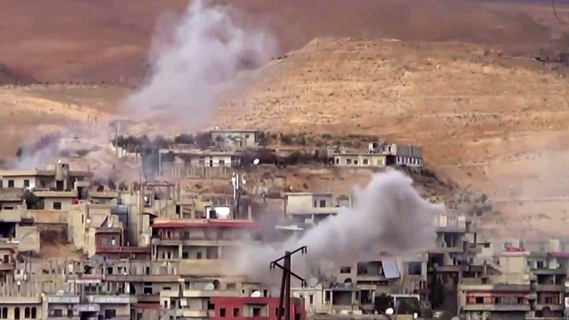 This frame grab from video provided By Step News Agency, a Syrian opposition media outlet that is consistent with independent AP reporting, shows smoke rise from the government forces shelling on Wadi Barada, northwest of Damascus, Syria. AP