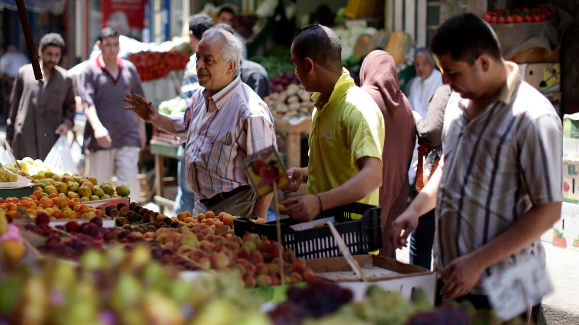Egyptians shop at a market in Cairo. (AP)