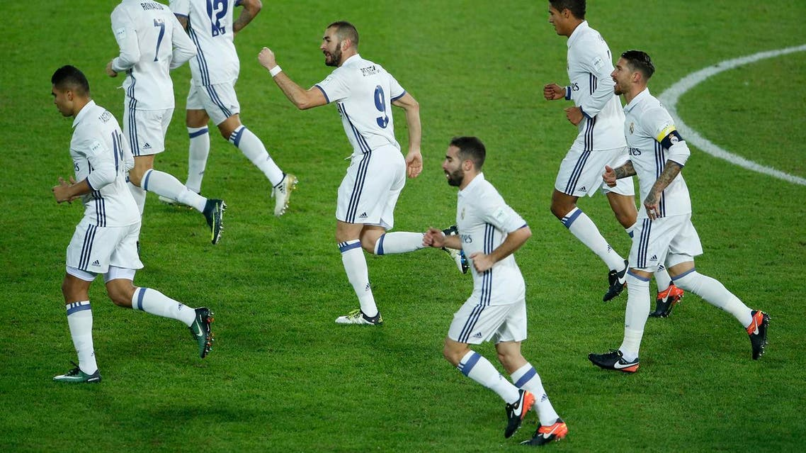 Real Madrid's Karim Benzema celebrates with team mates after scoring the first goal for his side. (Reuters)